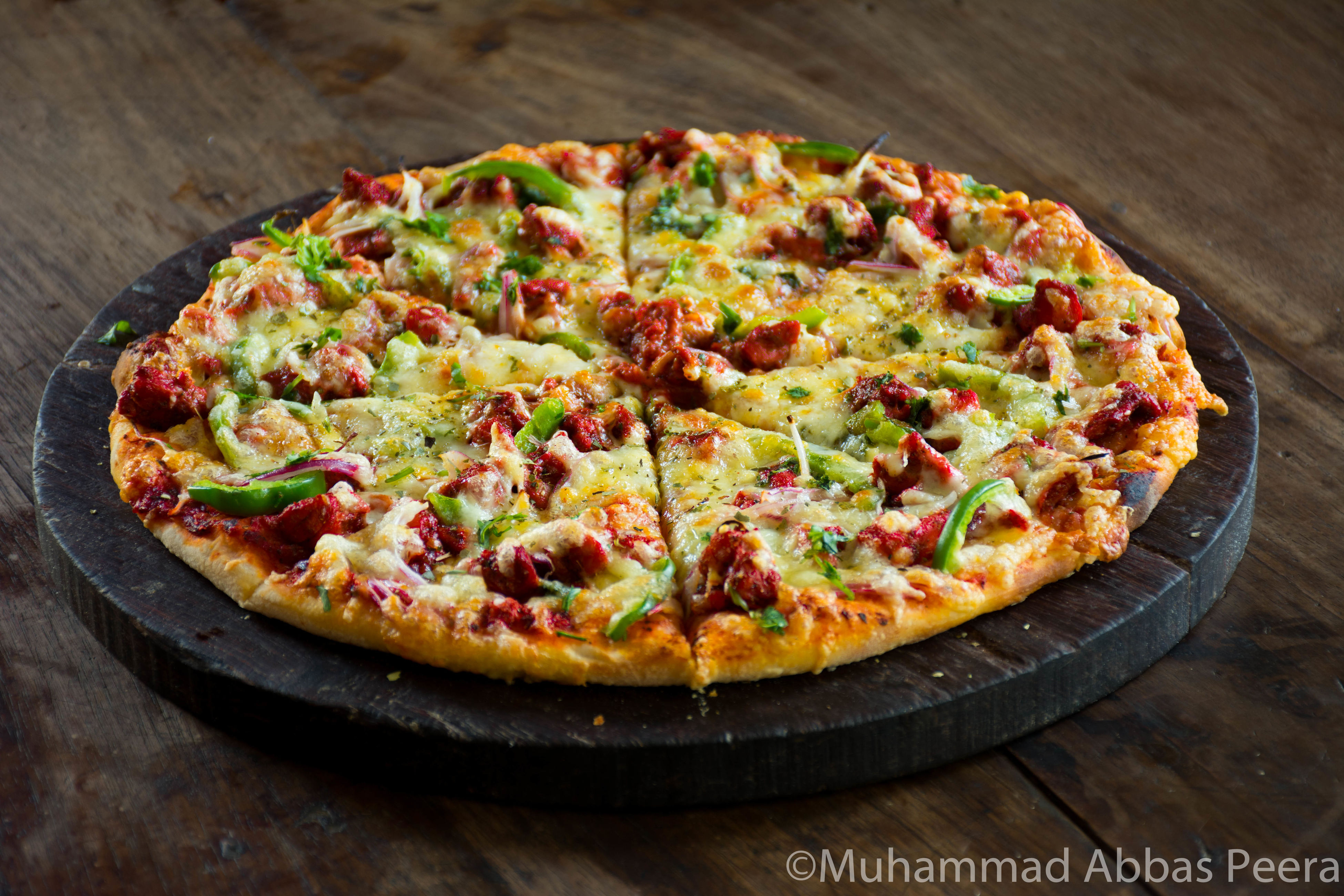 food, pizza, food and drink, table, indoors, high angle view, wood - material, no people, freshness, italian food, vegetable, cheese, ready-to-eat, homemade, plate, studio shot, vegetarian food, close-up, day