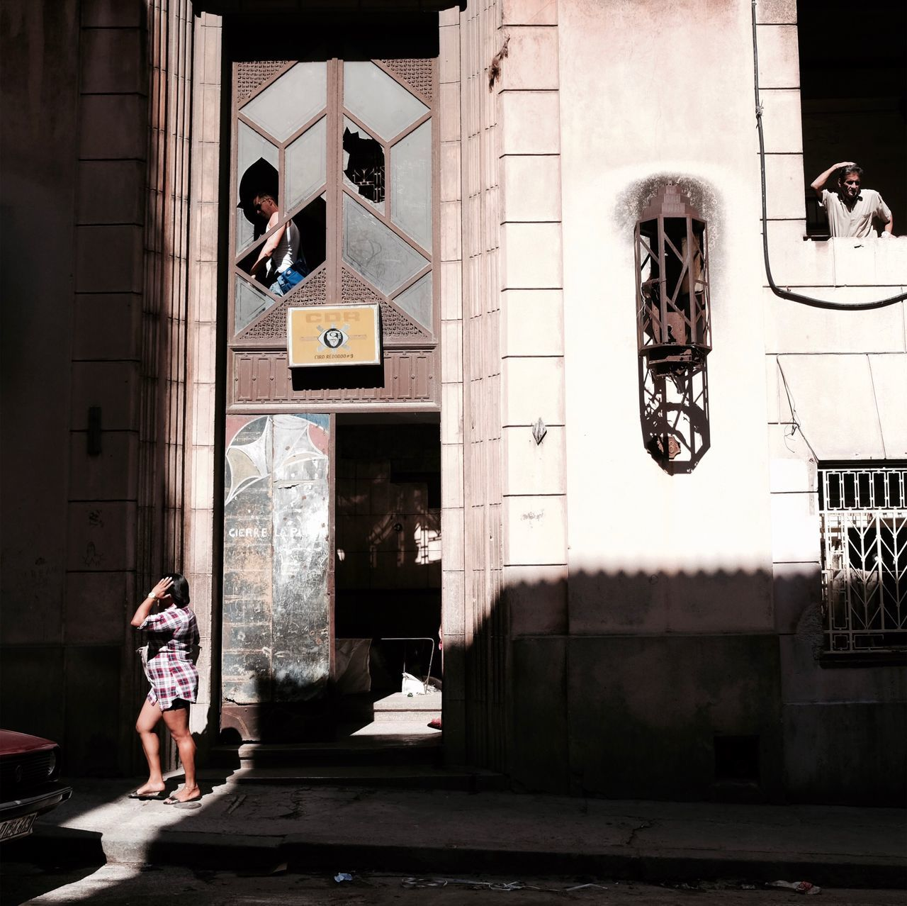 Full Length Real People Architecture Building Exterior Built Structure One Person Standing Casual Clothing Walking Day Outdoors Women Photographing Men Adult People Havana Cuba Travel