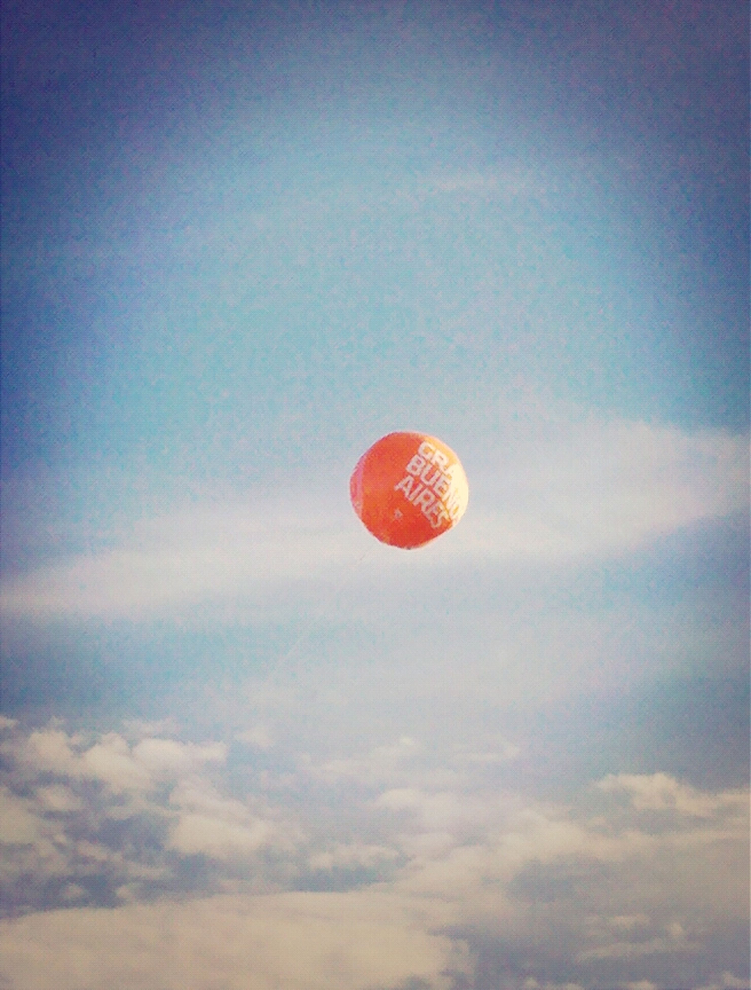 low angle view, sky, hot air balloon, circle, balloon, red, mid-air, scenics, copy space, tranquility, sun, beauty in nature, nature, tranquil scene, outdoors, cloud - sky, no people, parachute, sphere, sunset