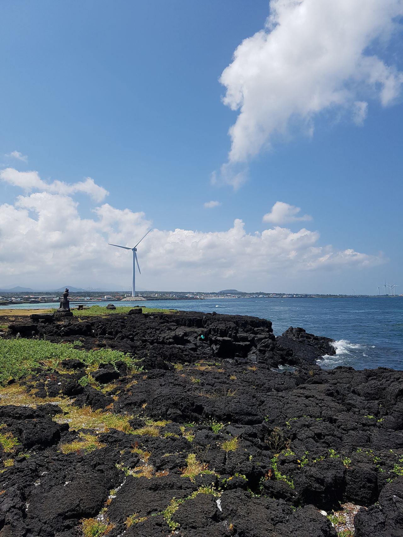 Offshore wind turbine at Weoljeonri beach Granitics Beach Wind Power Wind Turbine Sea Beauty In Nature Jeju Island, Korea Blue Sky And Sea Summer Time  Trip Photos Korea