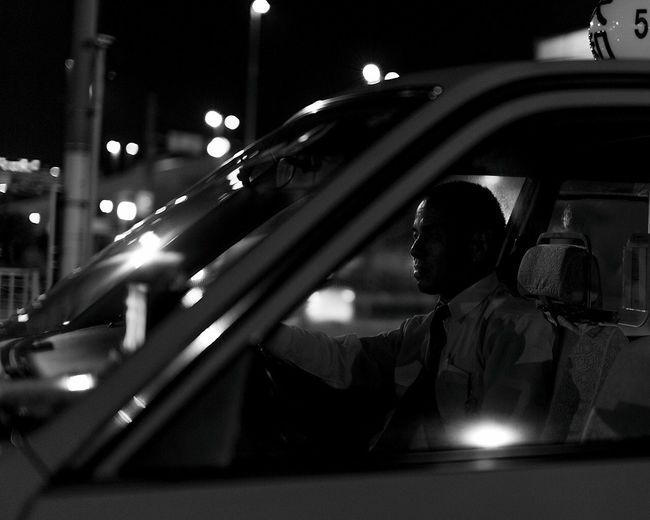 Taxi Driver Transportation Car Close-up Focus On Foreground Person Outdoors Japan Night Taxi Taxi Driver Light Followme Mode Of Transport Japan Photography Tokyo Monochrome Photography Dark Canon Canon6d Sigma Sigmalens People Watching