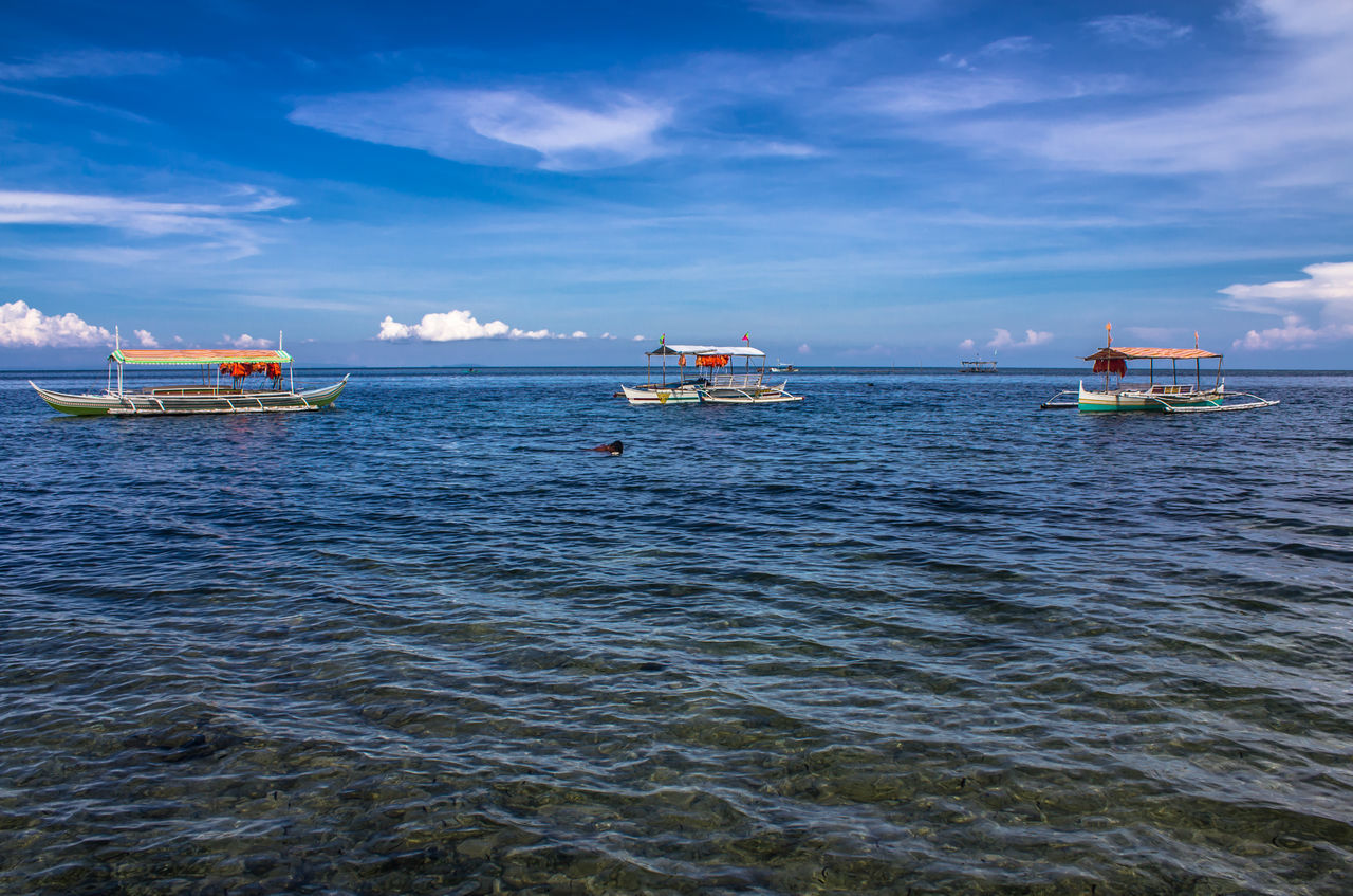 Anchored Boats Blue Blue Sea Blue Sky Boats And Water Check This Out EyeEm Best Shots EyeEm Nature Lover Eyeem Philippines Fishing Boats Horizon Horizon Over Water Personal Perspective Perspective Swimming Swimming Alone Swimming At The Beach
