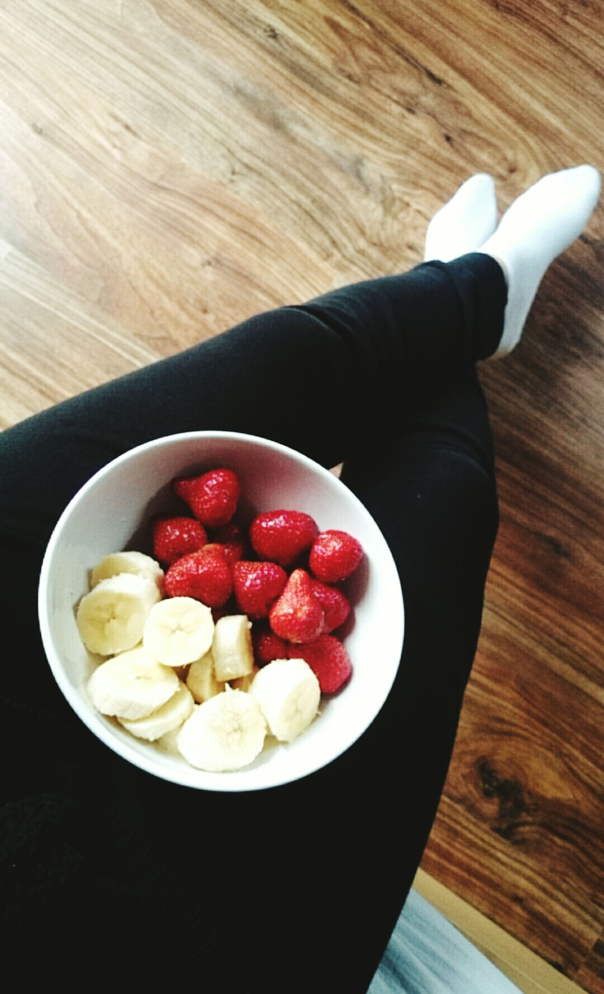 food and drink, food, freshness, indoors, fruit, healthy eating, red, table, high angle view, person, sweet food, strawberry, holding, still life, bowl, directly above, indulgence