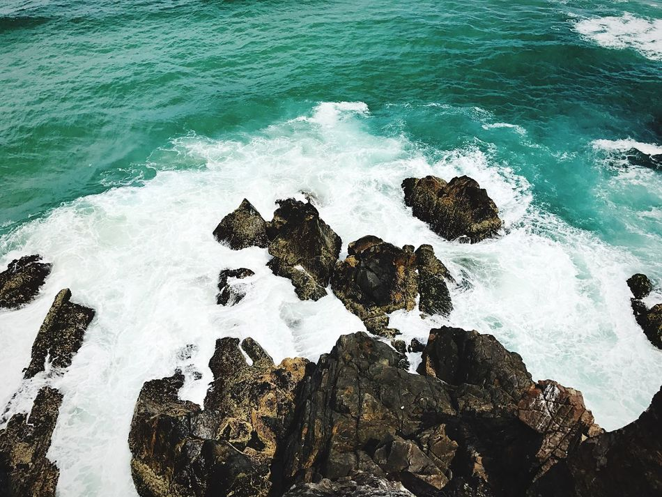Sea Rock - Object Wave Surf Water Beach High Angle View Nature No People Motion Beauty In Nature Outdoors Power In Nature Rocky Coastline Crashing Day Australia Queensland