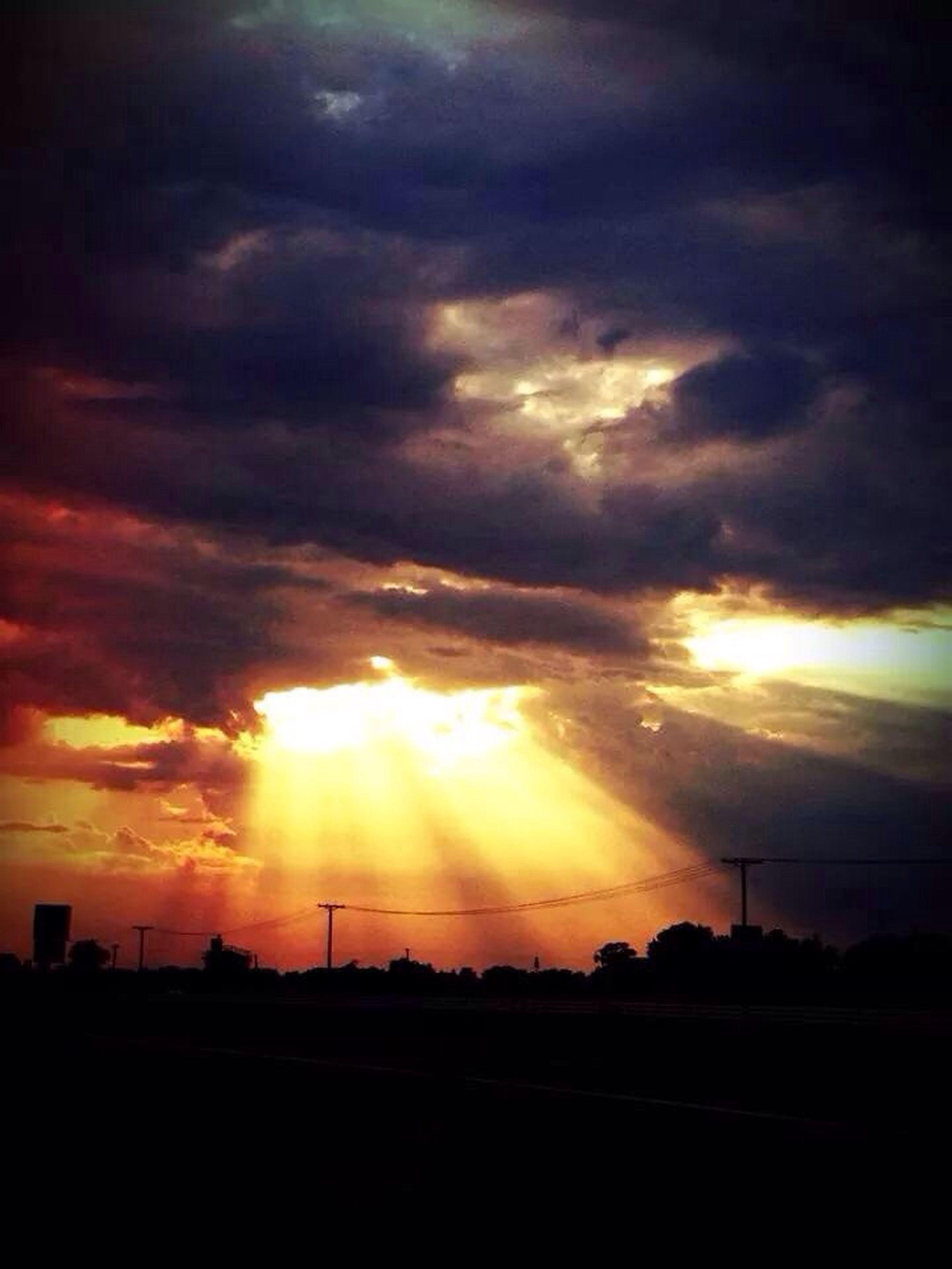 sunset, silhouette, sky, cloud - sky, sun, scenics, beauty in nature, orange color, dramatic sky, tranquil scene, cloudy, tranquility, nature, idyllic, sunbeam, landscape, weather, cloud, sunlight, atmospheric mood