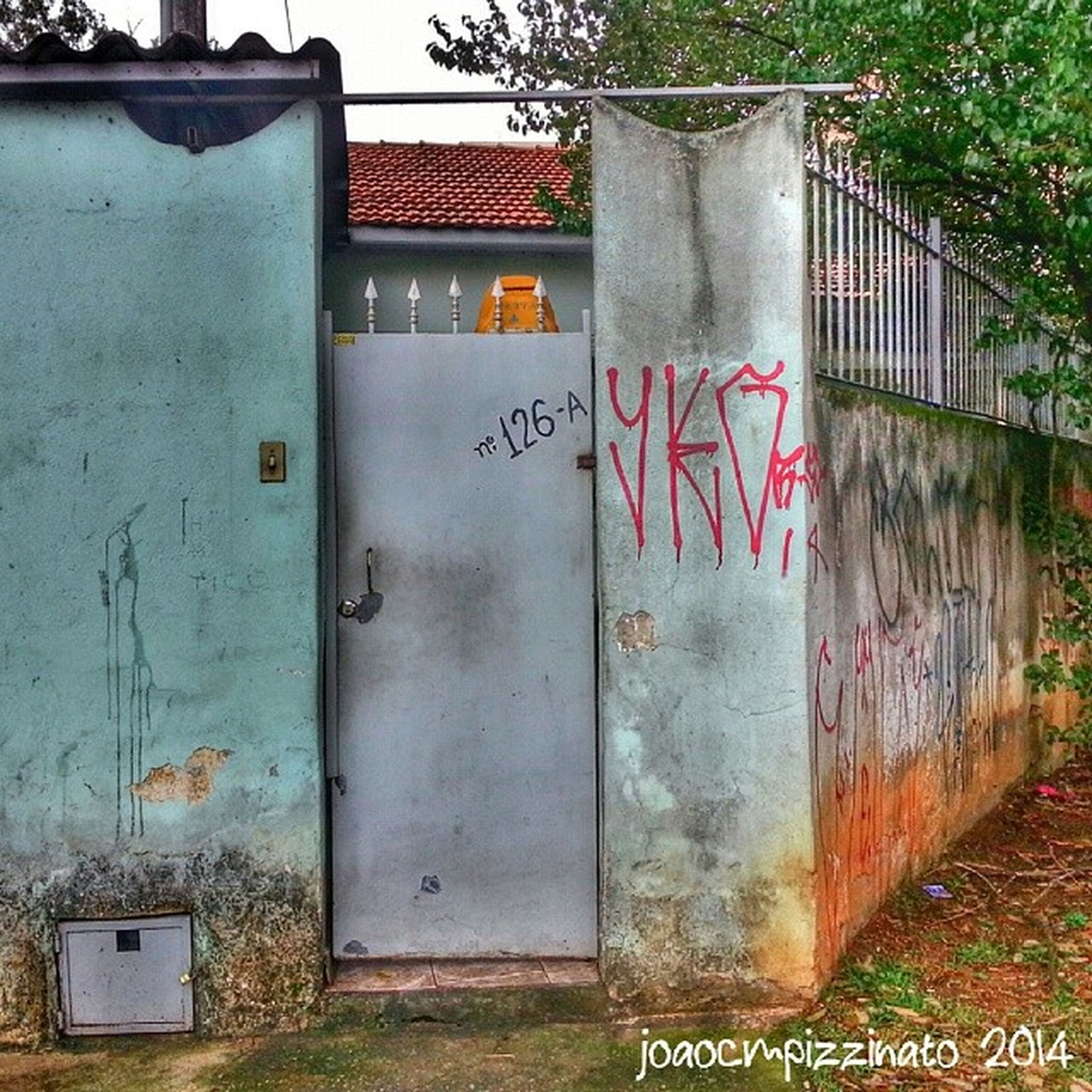 architecture, built structure, building exterior, graffiti, text, weathered, door, wall - building feature, old, house, abandoned, western script, closed, communication, run-down, residential structure, building, damaged, obsolete, window