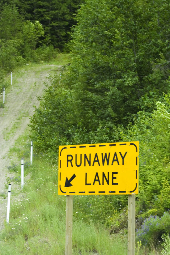 runaway lane uphill - security in the mountains for trucks with hot brakes Arrow Arrow Symbol Brake Communication Emergency Emergency Exit Guidance Hot Brakes Lane Mountain Nature No People Outdoors Overheat Road Road Sign Runaway Runaway Lane Safety Sign Signboard Text Traffic Truck Uphill
