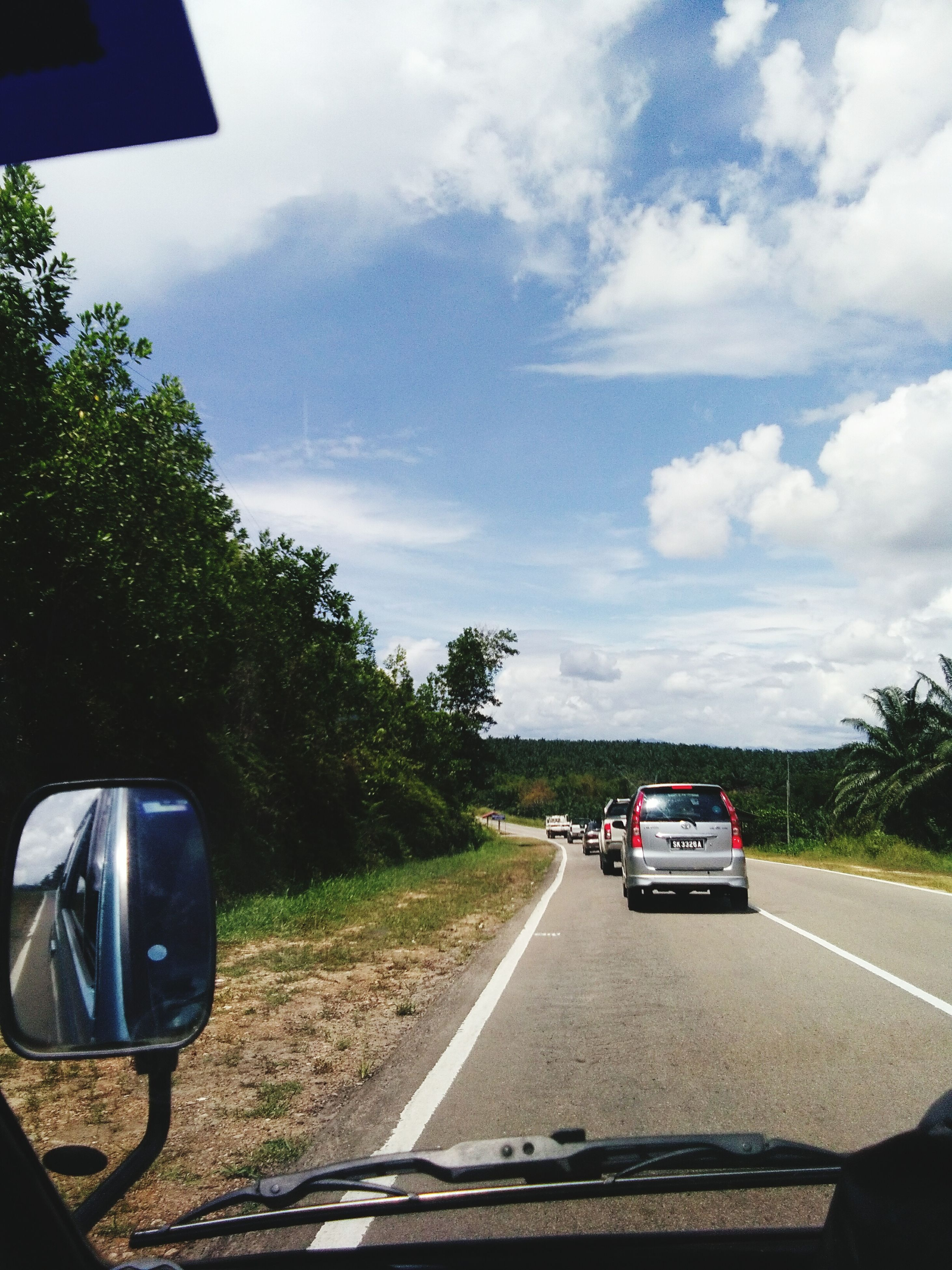 car, transportation, land vehicle, road, mode of transport, sky, cloud - sky, day, tree, car interior, side-view mirror, driving, outdoors, no people, road trip, nature