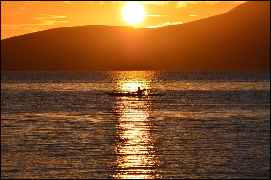 Sunset behind Arran  Sunset Sea Scenics Beauty In Nature Nature Reflection Sun Water Sky Sunlight Tranquility Waterfront Outdoors Silhouette Real People Horizon Over Water Day Canoing Silhouette Water Surface Ripples Waves Orange Color First of a group of photos taken during glorious sunset looking across to the Isle of Arran