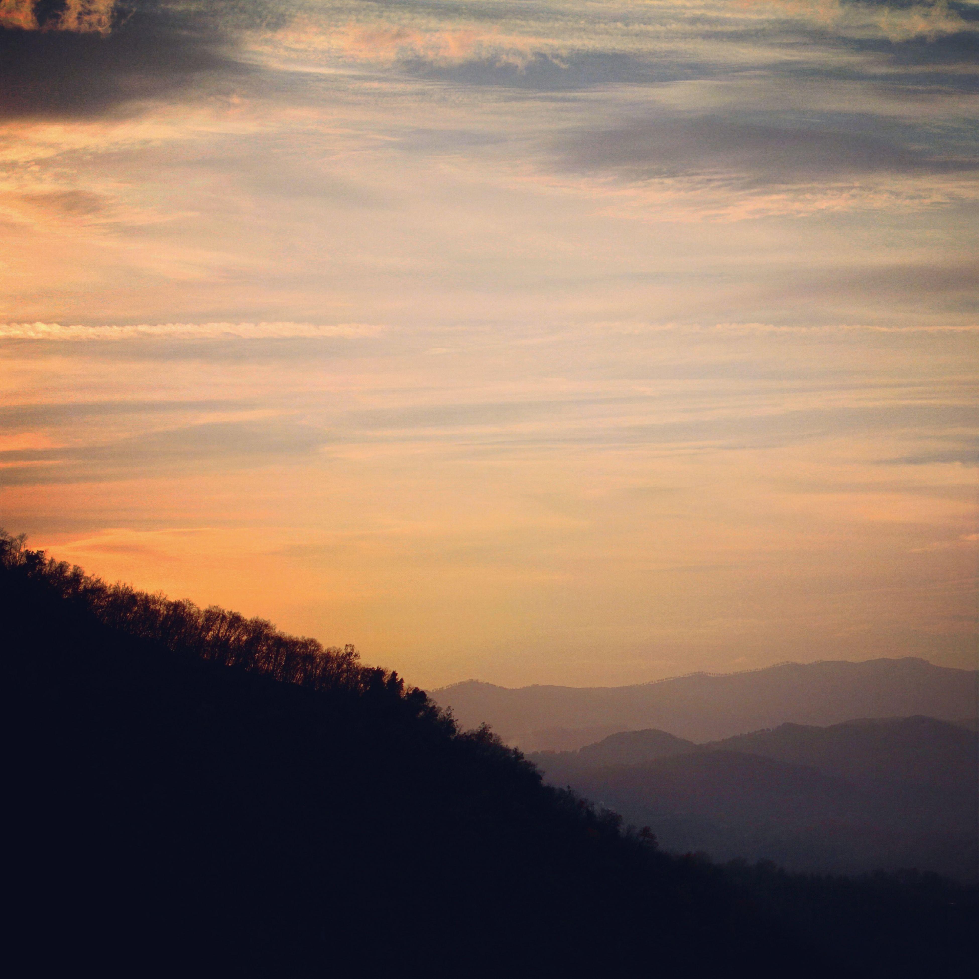 silhouette, scenics, tranquil scene, sunset, tranquility, beauty in nature, sky, mountain, landscape, tree, nature, idyllic, cloud - sky, mountain range, non-urban scene, cloud, orange color, outdoors, no people, dusk