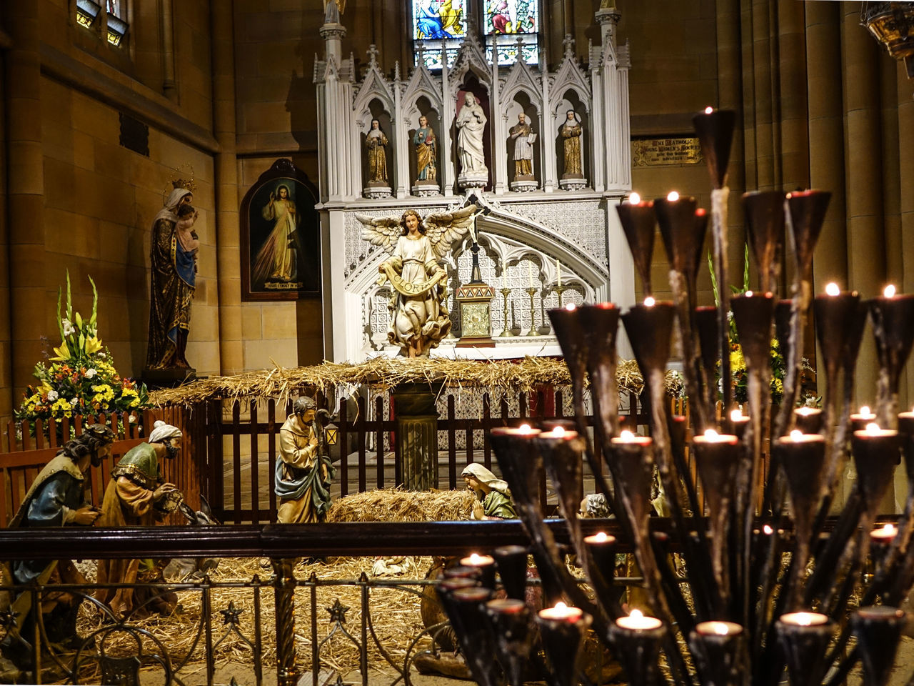 The Cathedral.. Candle Cathedral Church Cultures Day God Is Great. Golden Historic Illuminated Indoors  Jesus Landmark Light Low Light No People Peace Place Of Worship Pure Religion St Mary's Cathedral Statue Sydney, Australia Travel Destinations