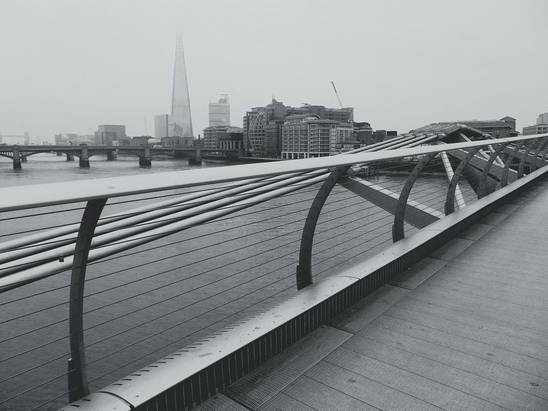 Built Structure City Architecture Metal City Life Travel Destinations Outdoors No People Water Cold Temperature Bridge Bridge View Travel England Blackandwhite Photography Wobbly Bridge Moody Sky Foggy Morning
