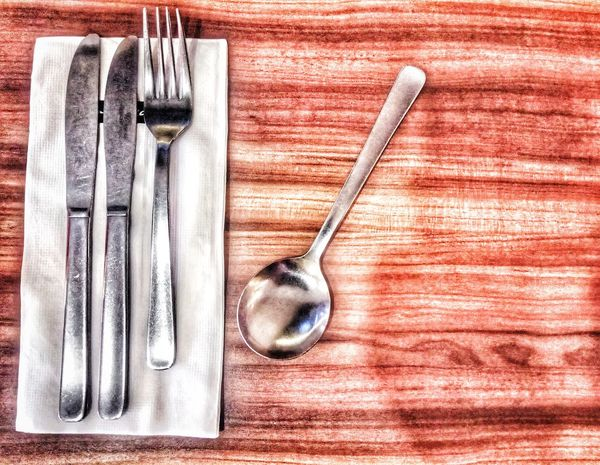 """""""Eat to live""""😊 Spoon Fork Wood - Material Wood Table EyeEm Selects Knives Ready-to-eat Table No People High Angle View Indoors  Fork Directly Above Close-up Day"""