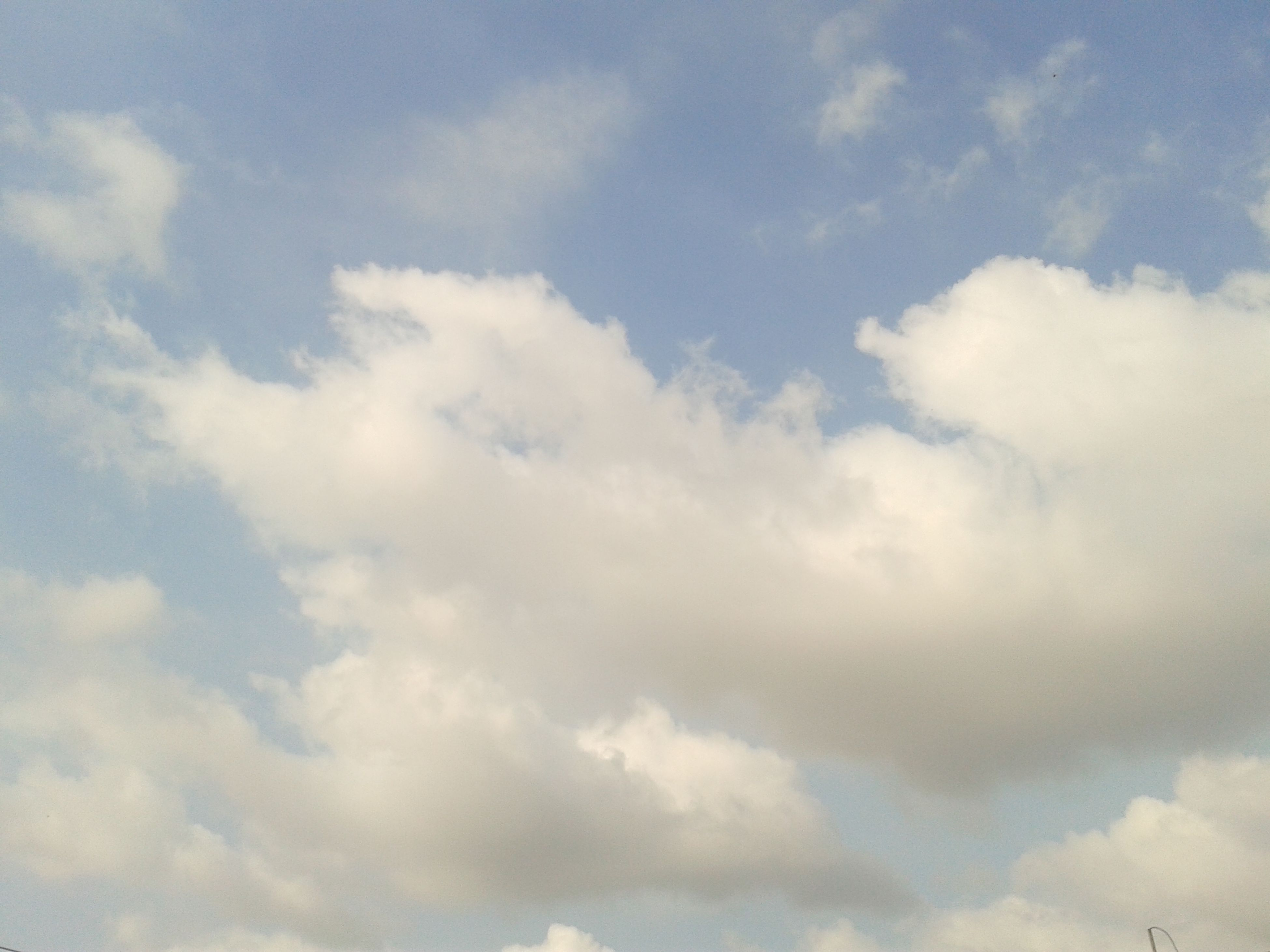 sky, cloud - sky, low angle view, sky only, beauty in nature, tranquility, cloudy, scenics, cloudscape, nature, tranquil scene, white color, backgrounds, cloud, full frame, idyllic, blue, weather, day, white