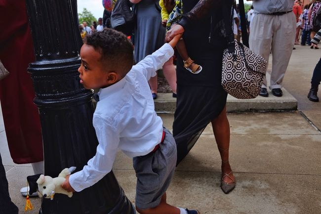 This little guy has Determination - Graduation Streetphotography Street Candid Fujifilm X70 Ohio Kids Kidsphotography Kid Mom Crowd The Street Photographer - 2016 EyeEm Awards