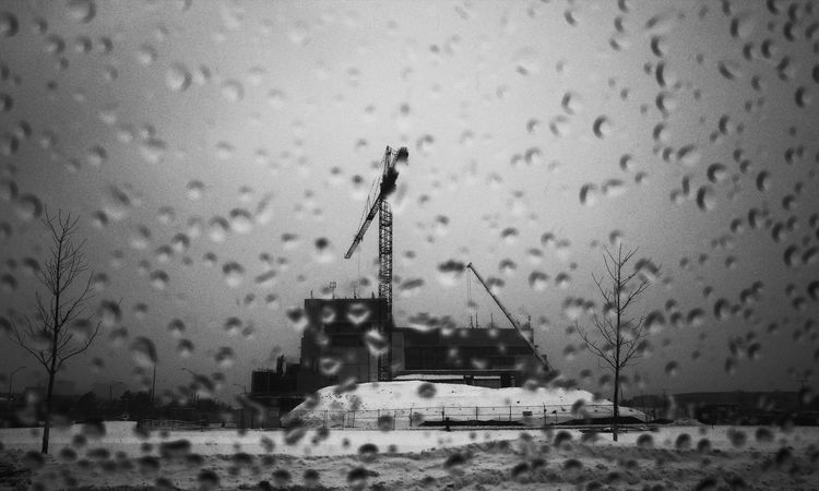 construction crane working rain or shine Monochrome Blackandwhite Contrast Sonya7II Rain Snow Crane Construction Building Architecture No People Built Structure Outdoors Water Winter Snow Cold Temperature Day Sky Building Exterior Nature