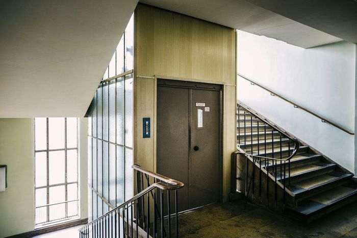 Stairwell with an old scary lift Funkhaus Nalepastrasse Berlin Rummelsburg GDR Old Building  Ostalgie Stairwell Lift Light And Shadow