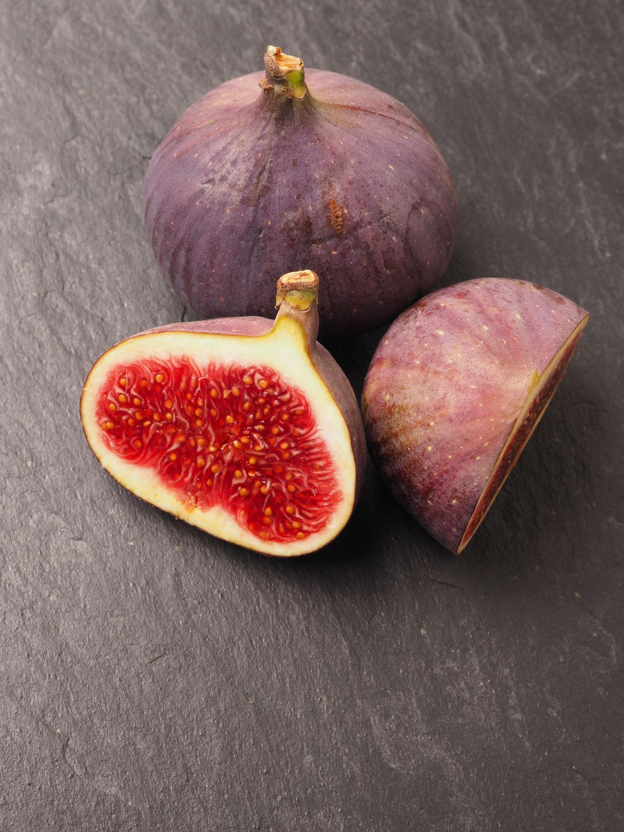 Fresh figs on dark slate Dark Slate Delicious Figs Food Freshness Fruits Healthy Eating Organic Food Stone Two Vegetables Vitamin