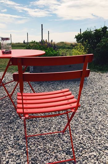Chair Table Sky Outdoors No People Red Day Cloud - Sky Tree Nature Full Frame Summer Red Furnitures Furniture Design Outdoor Cafe Cafe Coastal Summer Vibes Summerday Möllebythesea Molle Sweden Brandstationen