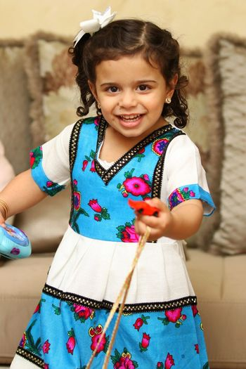Childhood Girl Cute Looking At Camera Smiling Portrait Traditional Clothing Playing Kid Saudi Arabia