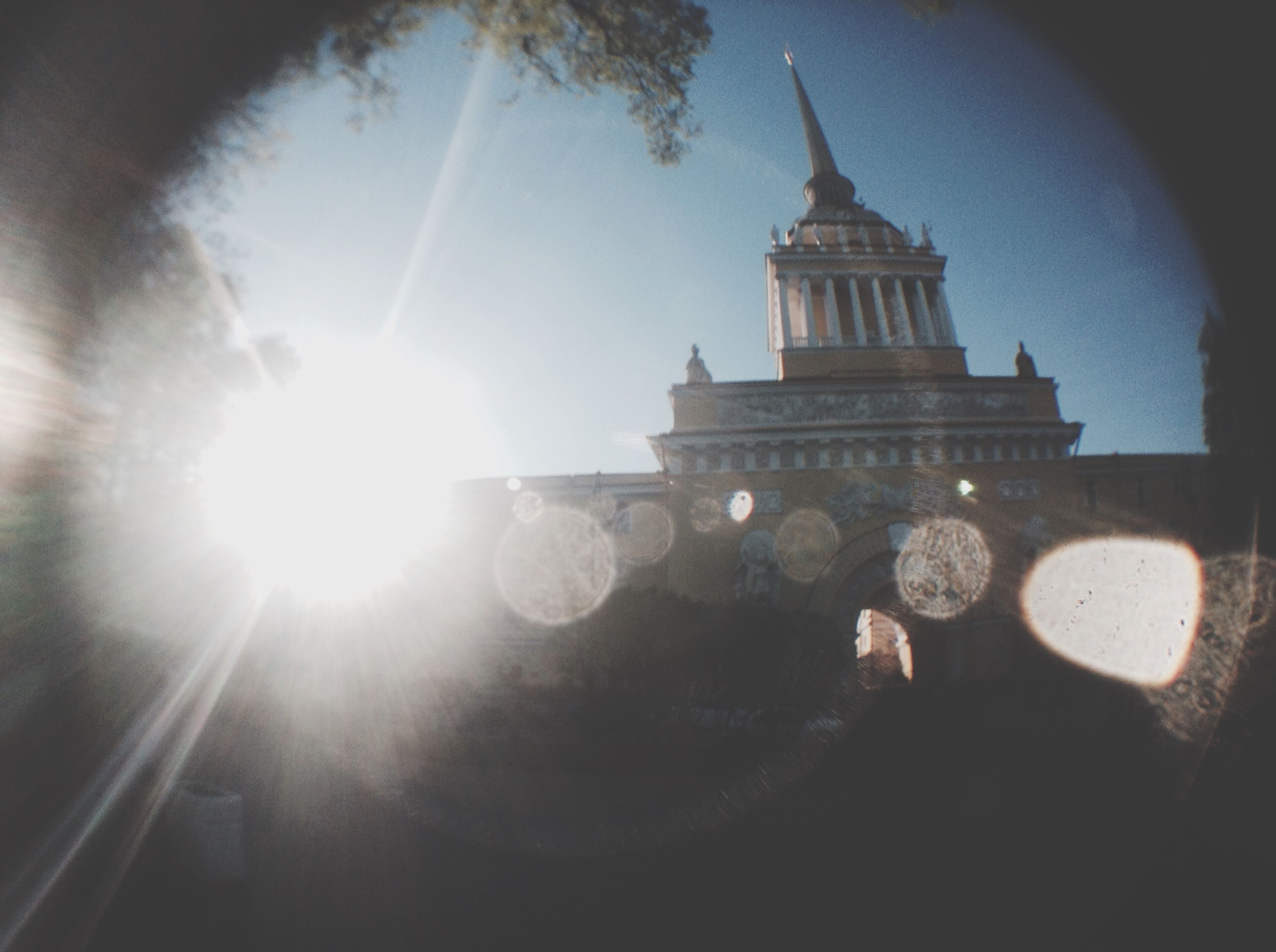 sun, sunbeam, built structure, architecture, sunlight, lens flare, low angle view, building exterior, sky, reflection, sunny, day, outdoors, clear sky, auto post production filter, religion, no people, church, bright