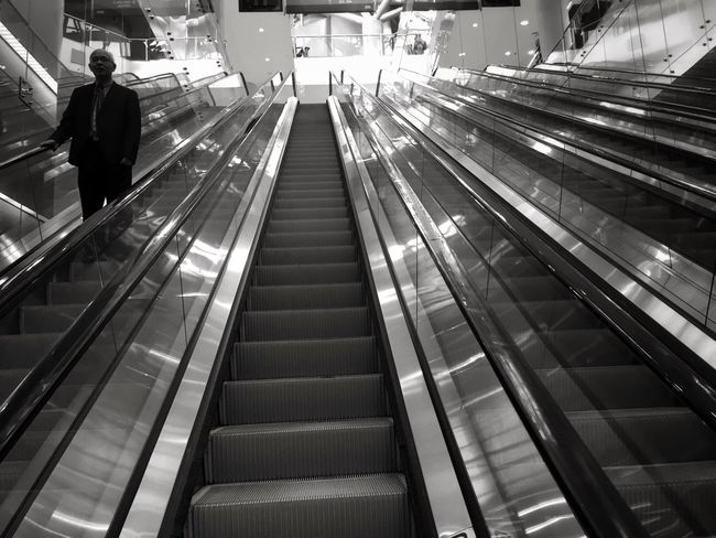 Opposite directions: Escalation Series Escalator Convenience Technology Motion On The Move Modern Person Architecture EyeEm Best Shots Bw_collection EyeEm Best Shots - Black + White Blackandwhite Black And White EyeEm Masterclass Shootermag Bw_lover Low Angle View EE_Daily: Black And White EyeEmBestPics EyeEm Gallery Light Building Story Inspirations Everywhere.