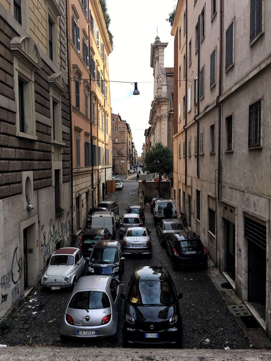 City Building Exterior Transportation Car Street Architecture Built Structure Mode Of Transport City Life Outdoors Road Day No People Cars Italy Italia Rome Parking Roma Vehicle Residential Building Architecture Parking Lot Parking Area Small Car