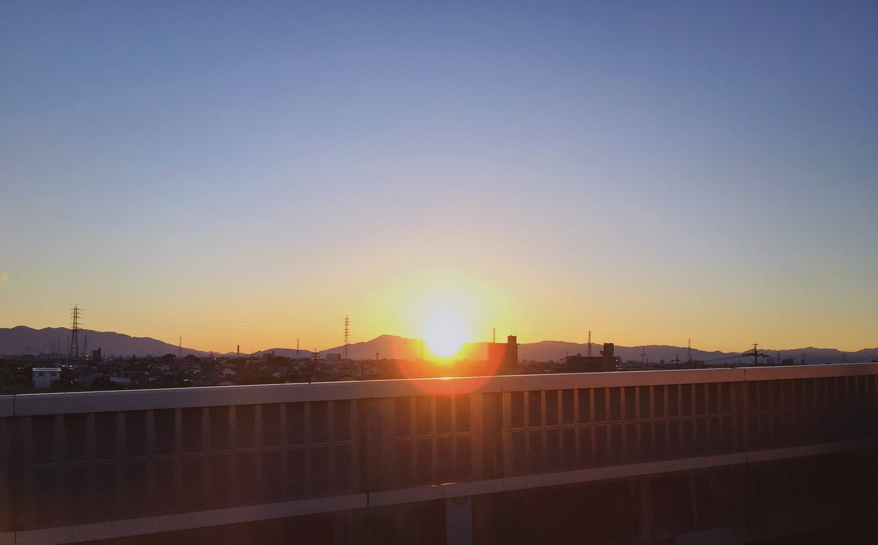 sunset, sun, sunlight, copy space, clear sky, architecture, no people, built structure, outdoors, building exterior, city, cityscape, nature, sky, day