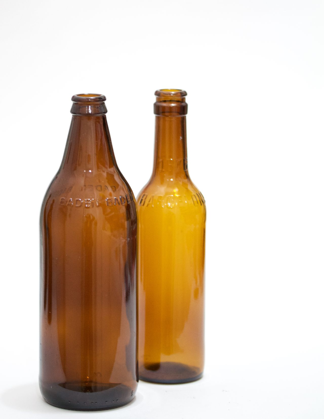 two brown bottles on white background Beer Bottle Brown Bottles Day Food Nature No People Studio Shot White Background