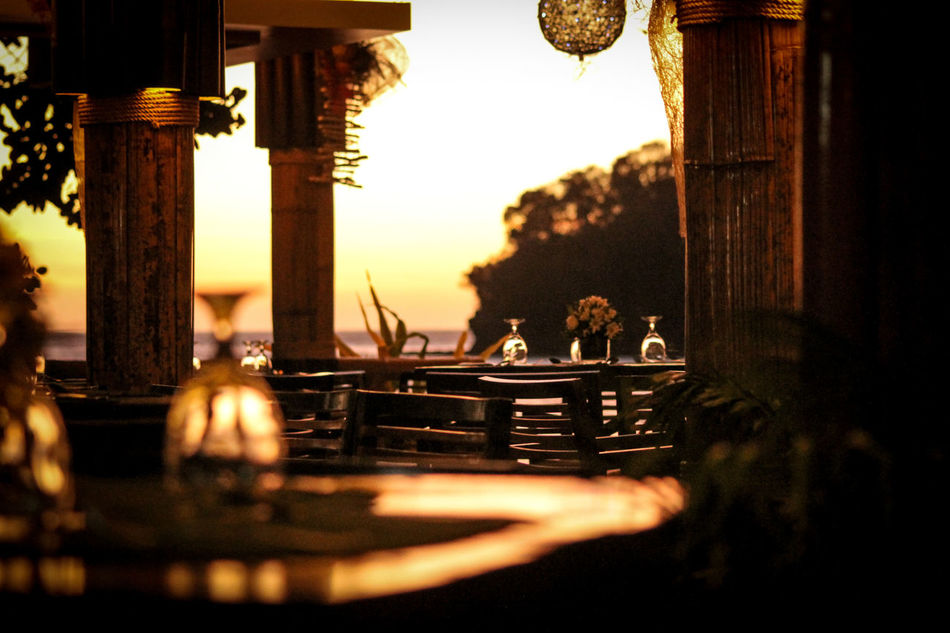 Reservation For Two Dinner Date Sunset In A Resort Sunset Silhouettes Dating Place Dating Scene No People Indoors  Resort Restaurant Interior Design Sunset Dating Romance Romantic Sunset Valentines Day Textured  Minimalism Shadow Togetherness Luxury Lifestyle Leisure Activity Still Life Photography Fine Art