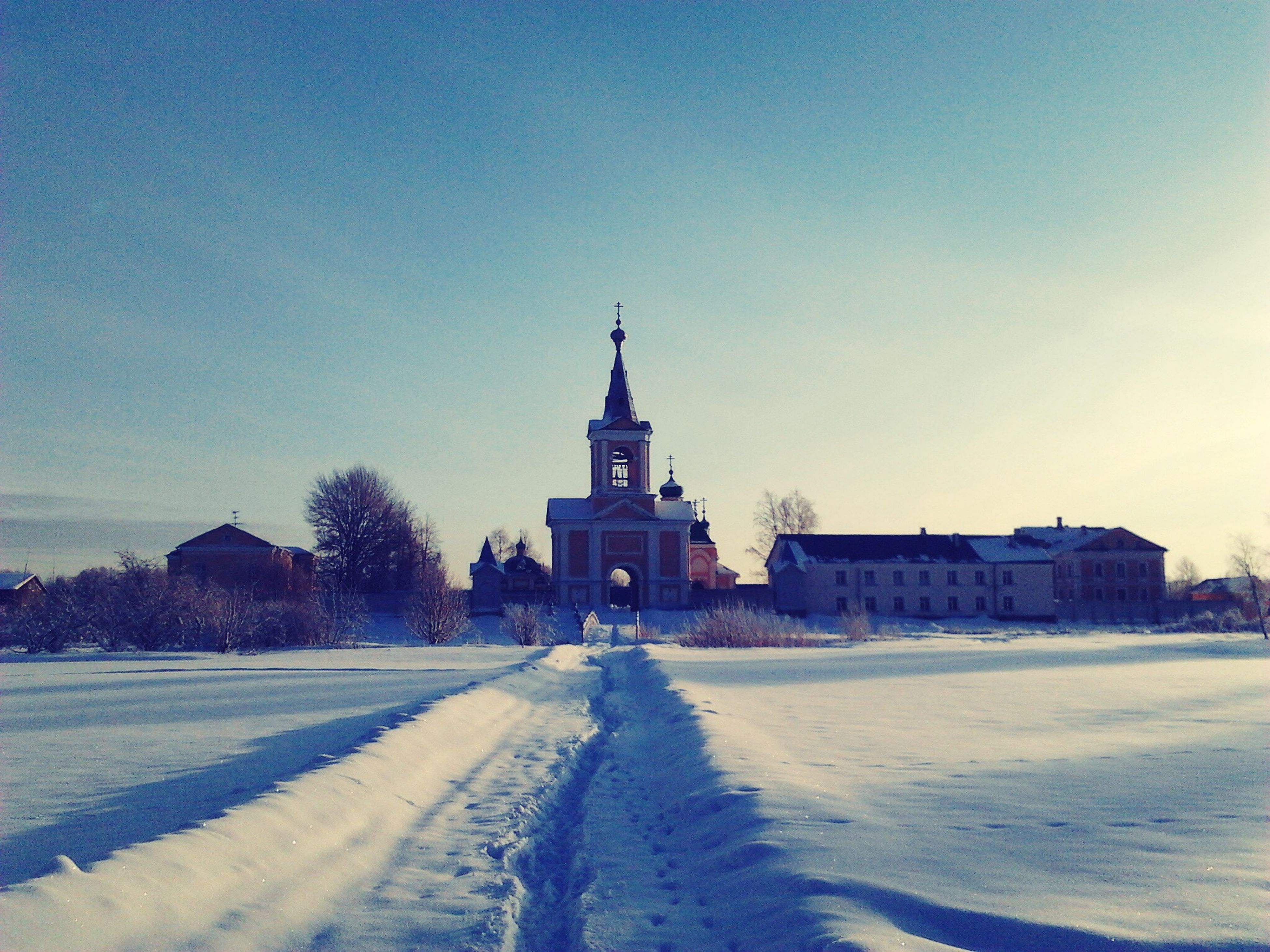 building exterior, architecture, built structure, snow, winter, cold temperature, clear sky, house, blue, sky, copy space, season, white color, nature, landscape, outdoors, sunlight, road, day, street