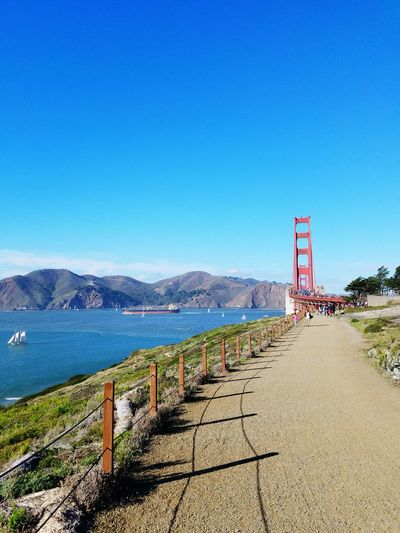 Blue Clear Sky Nature Outdoors Day Landscape Trees Waves Lands End San Francisco Pacific Ocean Water City Life Urban Life Architecture Sail Boat Shipping Boat San Francisco Bay Day Blue Sky Water Green Naturebeauty Man Made Structure Bridge - Man Made Structure