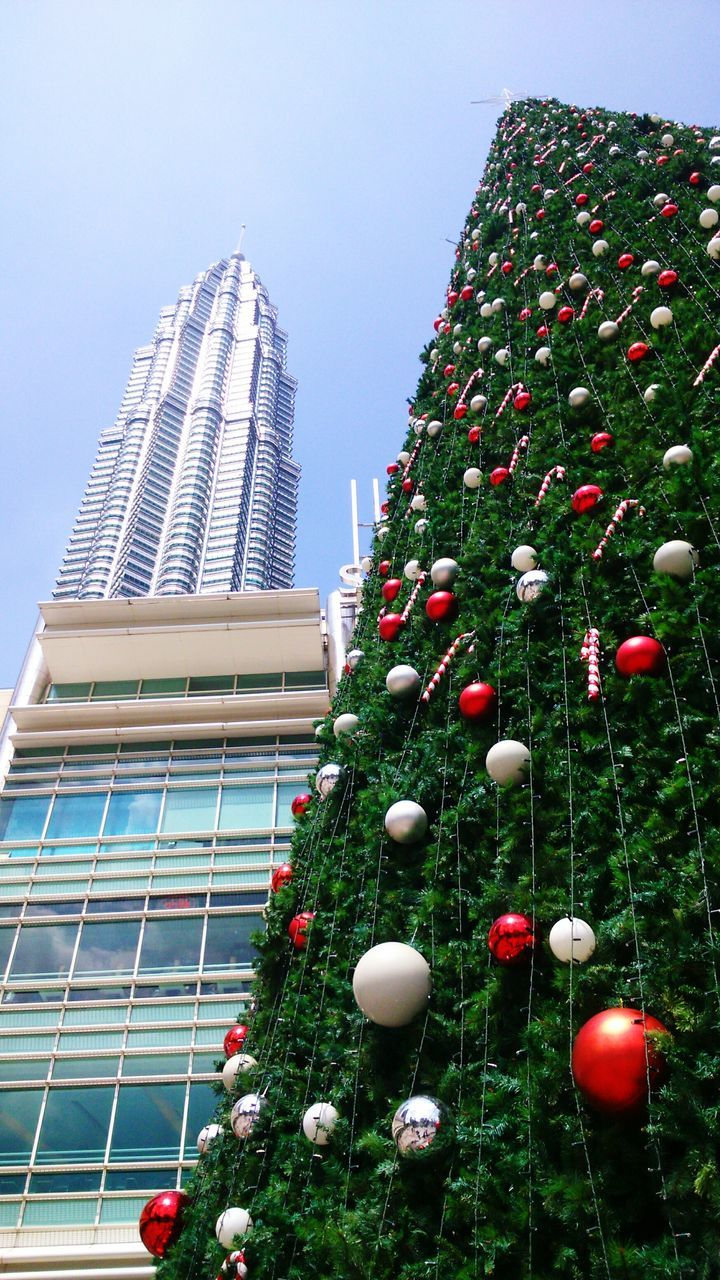 christmas, architecture, christmas tree, building exterior, built structure, low angle view, modern, no people, celebration, christmas decoration, day, tree, skyscraper, outdoors, city, sky