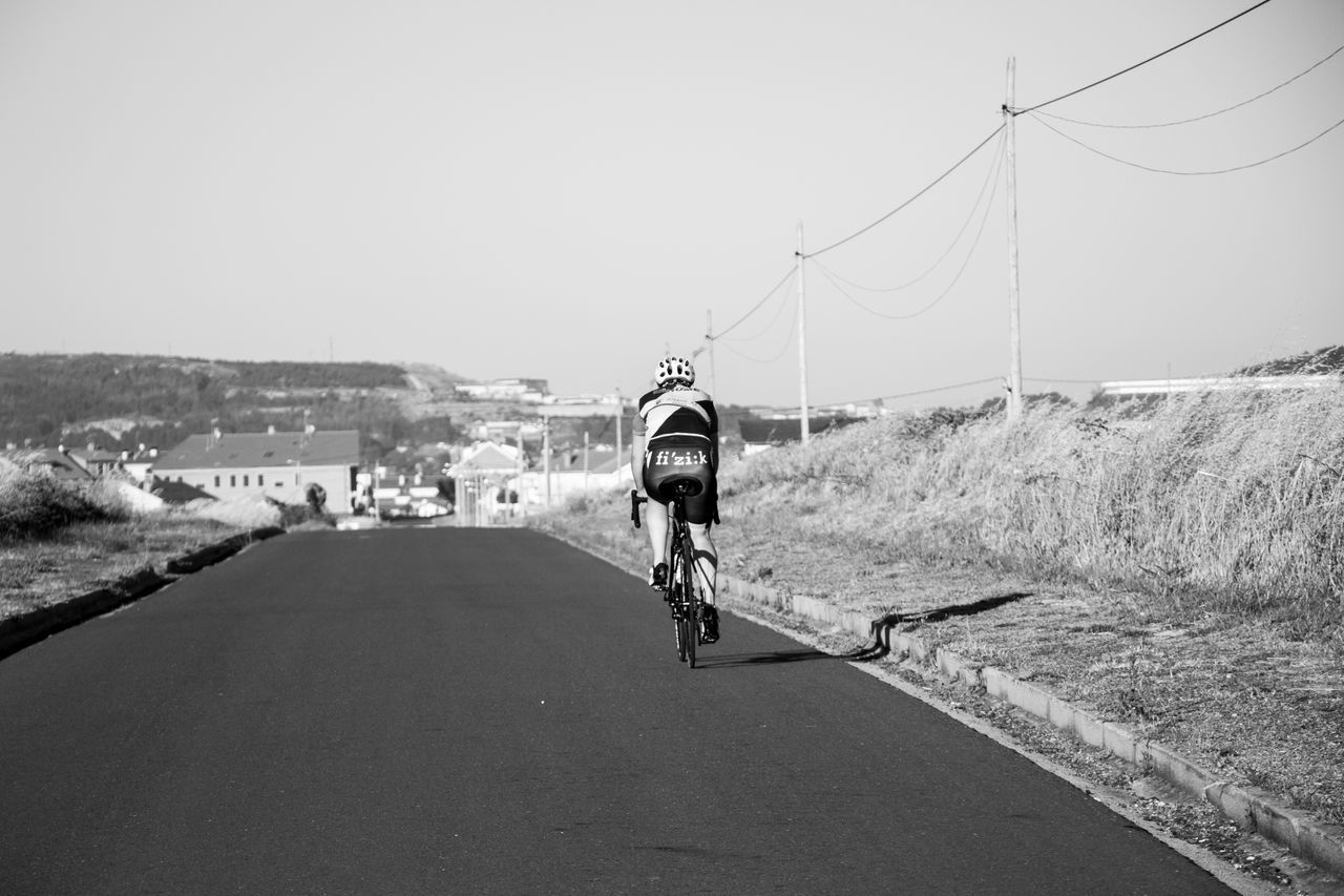 feeling good... Alone Bicycle Black & White Blackandwhite Ciclismo Clear Sky Connection Cycling Direction Feeling Good Galicia Land Vehicle Lifestyles Men Mode Of Transport Outdoors Perspective Real People Riding SPAIN Sport In The City Sports Street The Way Forward Transportation