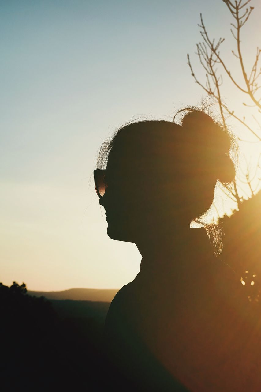 young adult, silhouette, sunset, young women, real people, side view, one person, lifestyles, sky, nature, outdoors, day