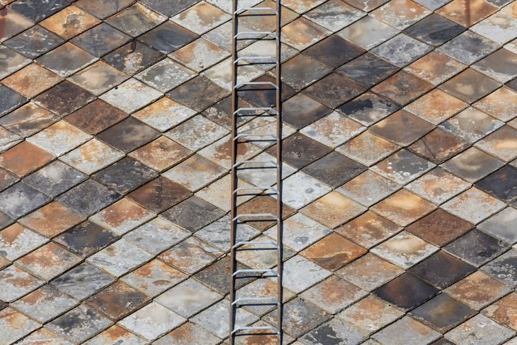 Ladder on a roof of an old house with weathered tiles (rhombus pattern) Architecture In A Row Ladder Roof Steps Weathered Abstract Abundance Aging Process Backgrounds Brown Checked Pattern Close-up Full Frame Geometric Shape Gray Multi Colored No People Old Outdoors Pattern Repetition Residential Building Roof Tile Textured