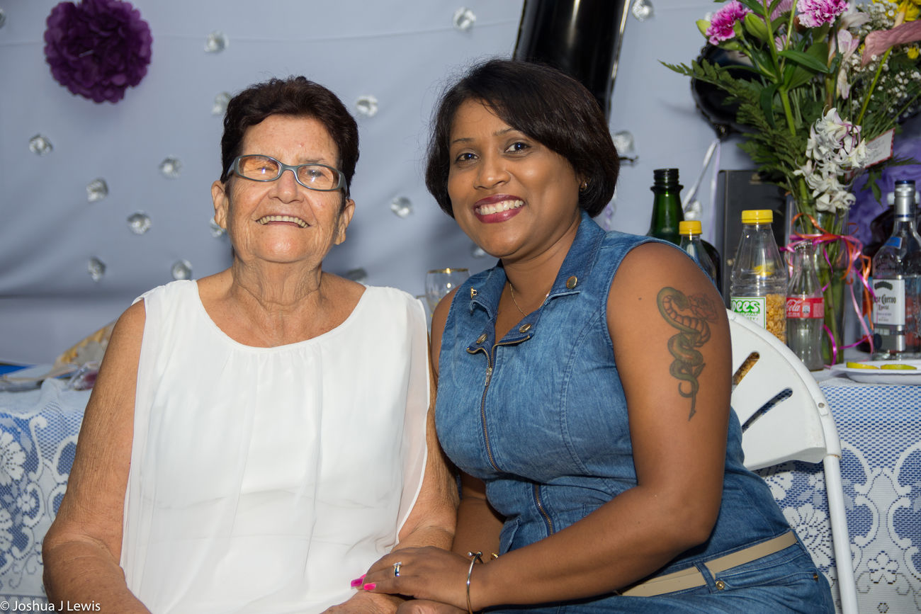 Togetherness Casual Clothing Family Time Senior Adult Smiling Birthdayparty Beautiful People Stillife Laughing Caribbean Trinidad And Tobago Real People Celebration Sitting