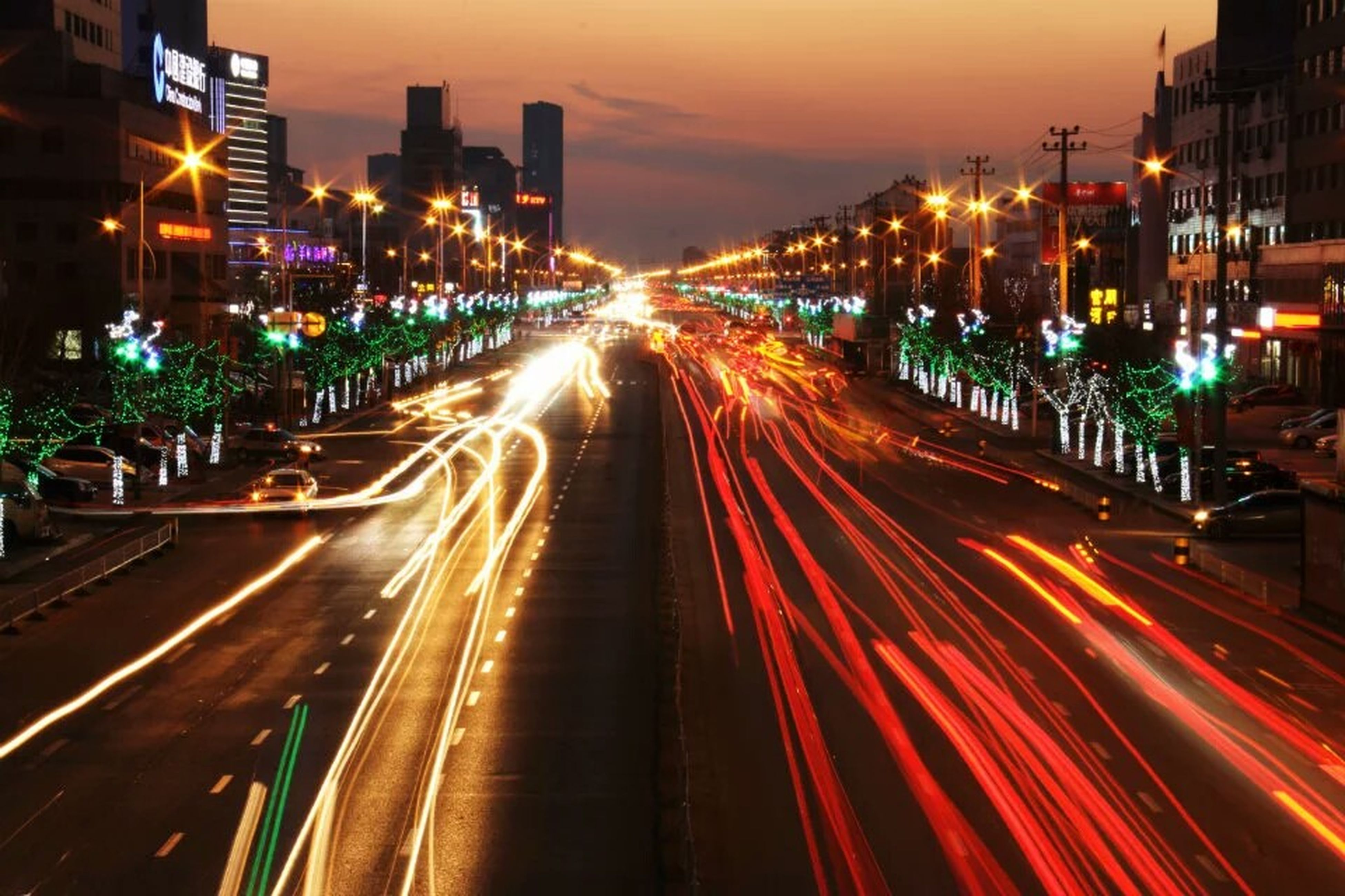 city, night, long exposure, traffic, illuminated, light trail, speed, city life, transportation, street, motion, city street, street light, dusk, cityscape, high angle view, car, road, architecture, highway, blurred motion, outdoors, skyscraper, travel destinations, building exterior, rush hour, nightlife, modern, no people, sky