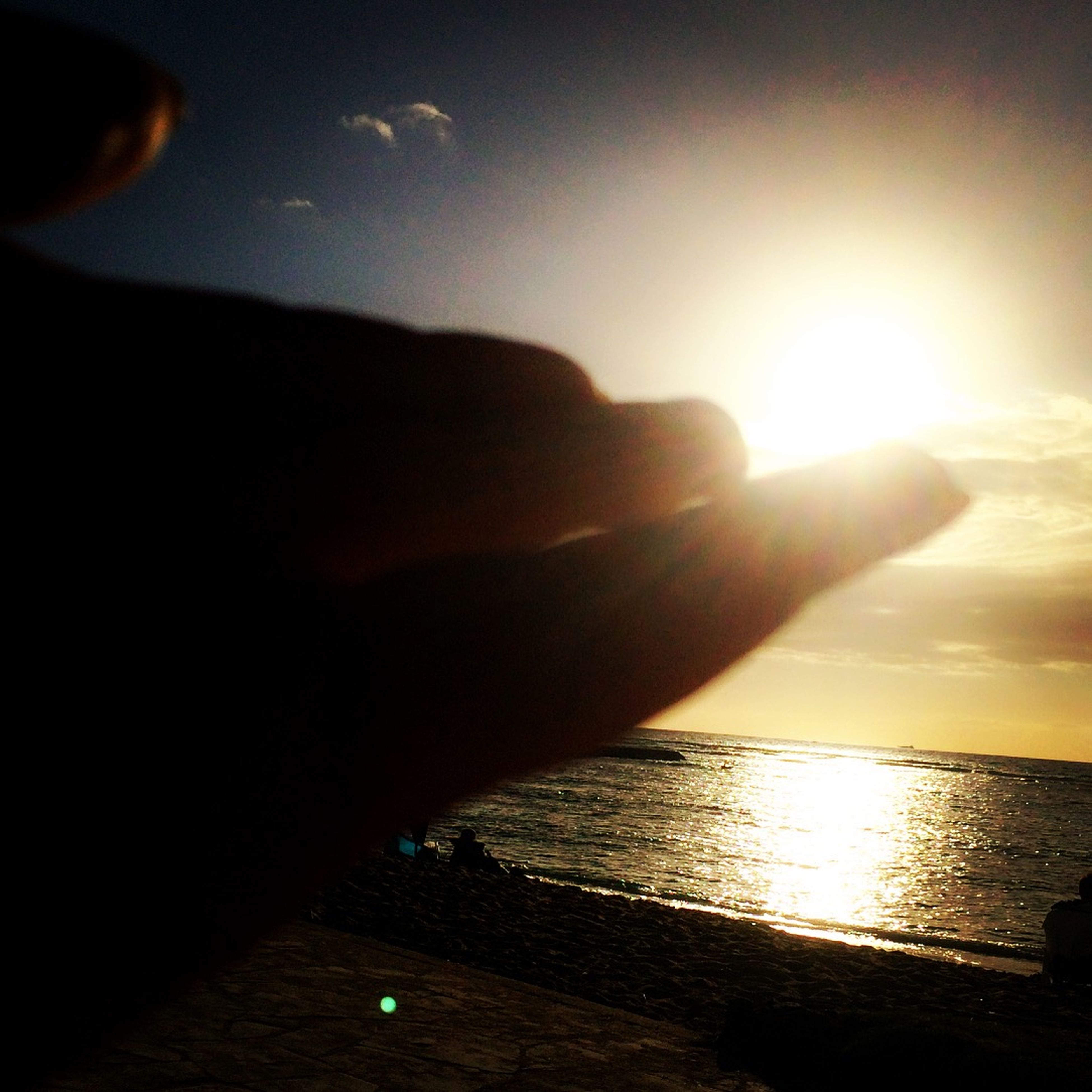 sun, sunset, person, part of, sunlight, cropped, sea, sunbeam, water, sky, lens flare, unrecognizable person, horizon over water, human finger, personal perspective, beach, silhouette