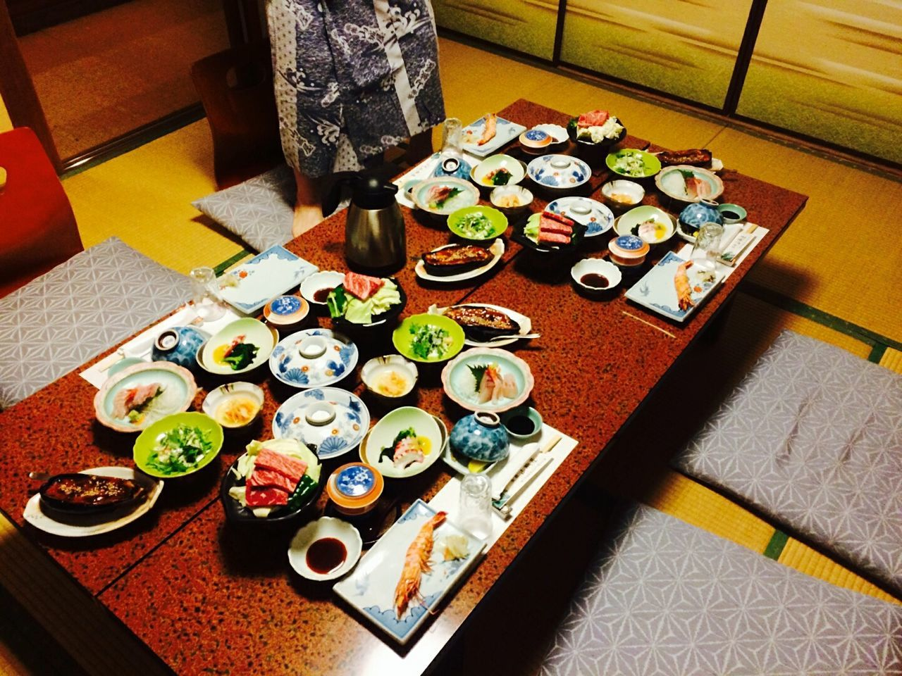 food and drink, variation, food, high angle view, large group of objects, choice, in a row, indoors, plate, table, drink, bowl, arrangement, sushi, retail, alcohol, healthy eating, real people, freshness, ready-to-eat, supermarket, day