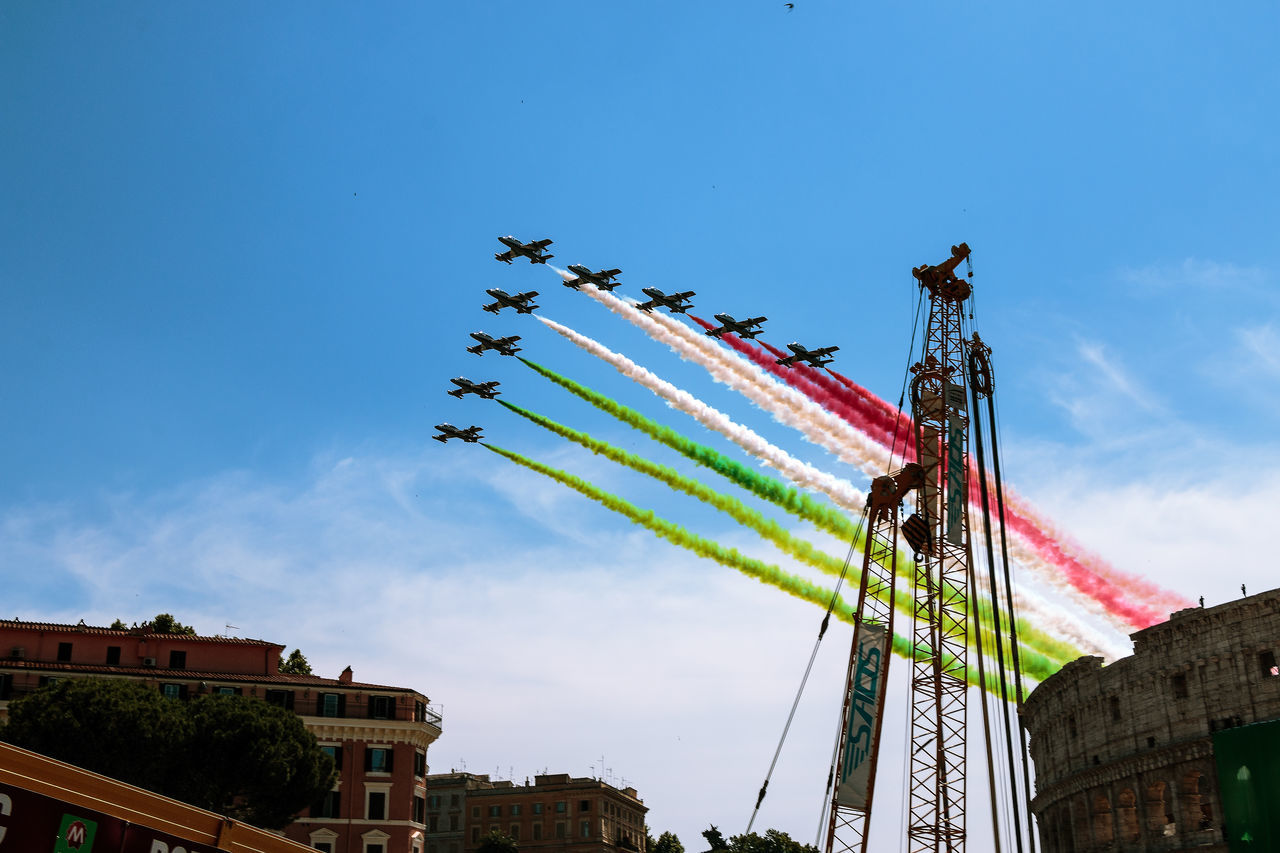 Republic Day Airshow Architecture Building Exterior Built Structure Cloud - Sky Day EyeEm Best Shots EyeEm Gallery Flag Low Angle View Mode Of Transport Multi Colored No People Outdoors Patriotism Planes Planes In The Sky Sky Teamwork Tricolor Arrows Vapor Trail