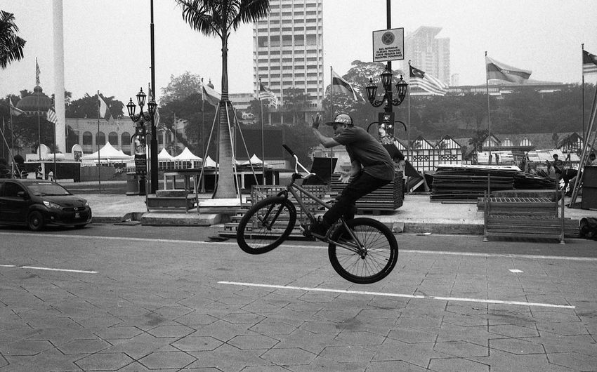 Talented Kids Everywhere // 2 Believeinfilm Bicycle City Life Cycling EyeEmMalaysia Filmisnotdead Leica M6 Leica_camera Lifestyles Mode Of Transport Riding Urban