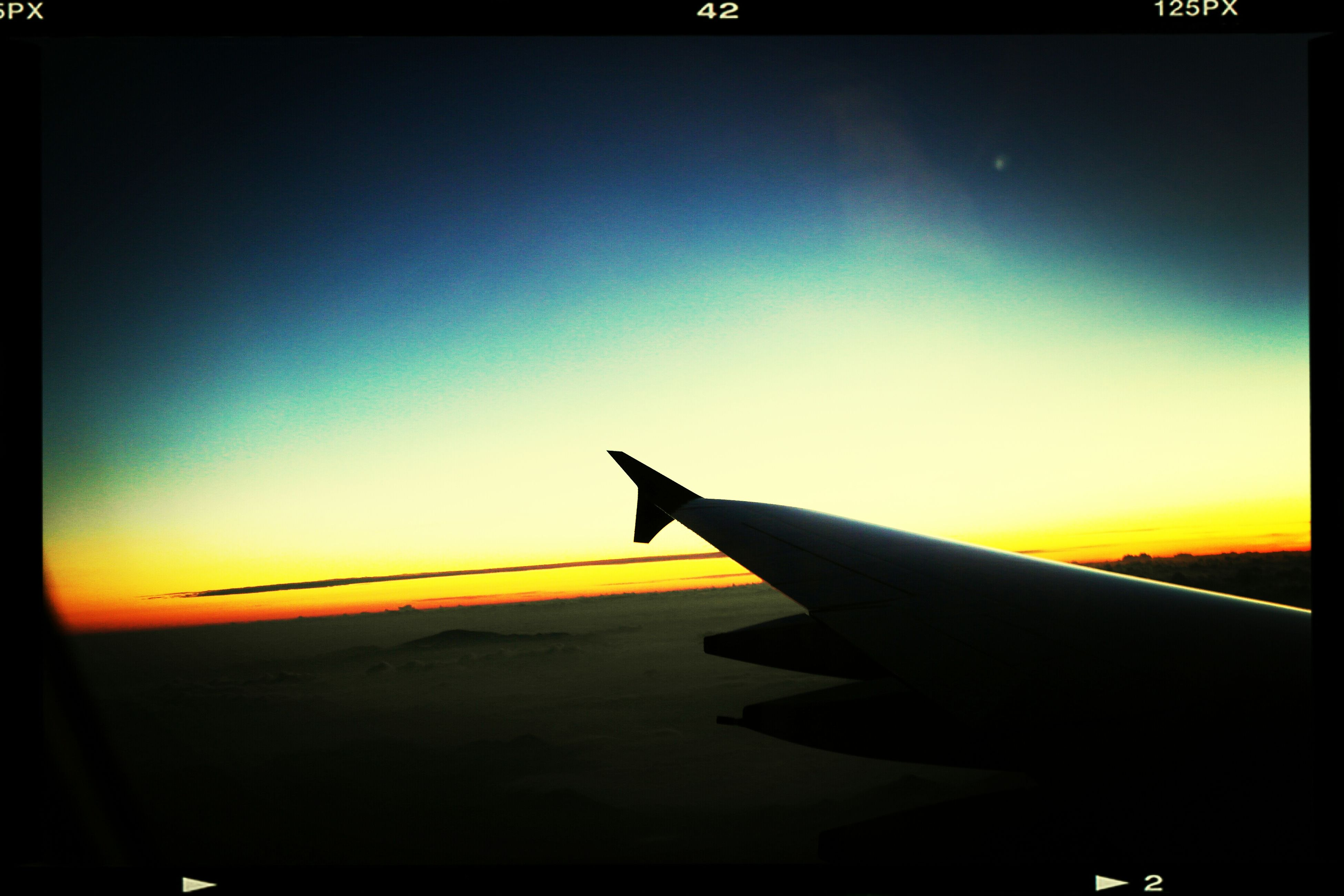 airplane, transportation, air vehicle, flying, aircraft wing, mode of transport, sunset, part of, sky, cropped, travel, mid-air, journey, transfer print, copy space, public transportation, on the move, auto post production filter, silhouette, clear sky