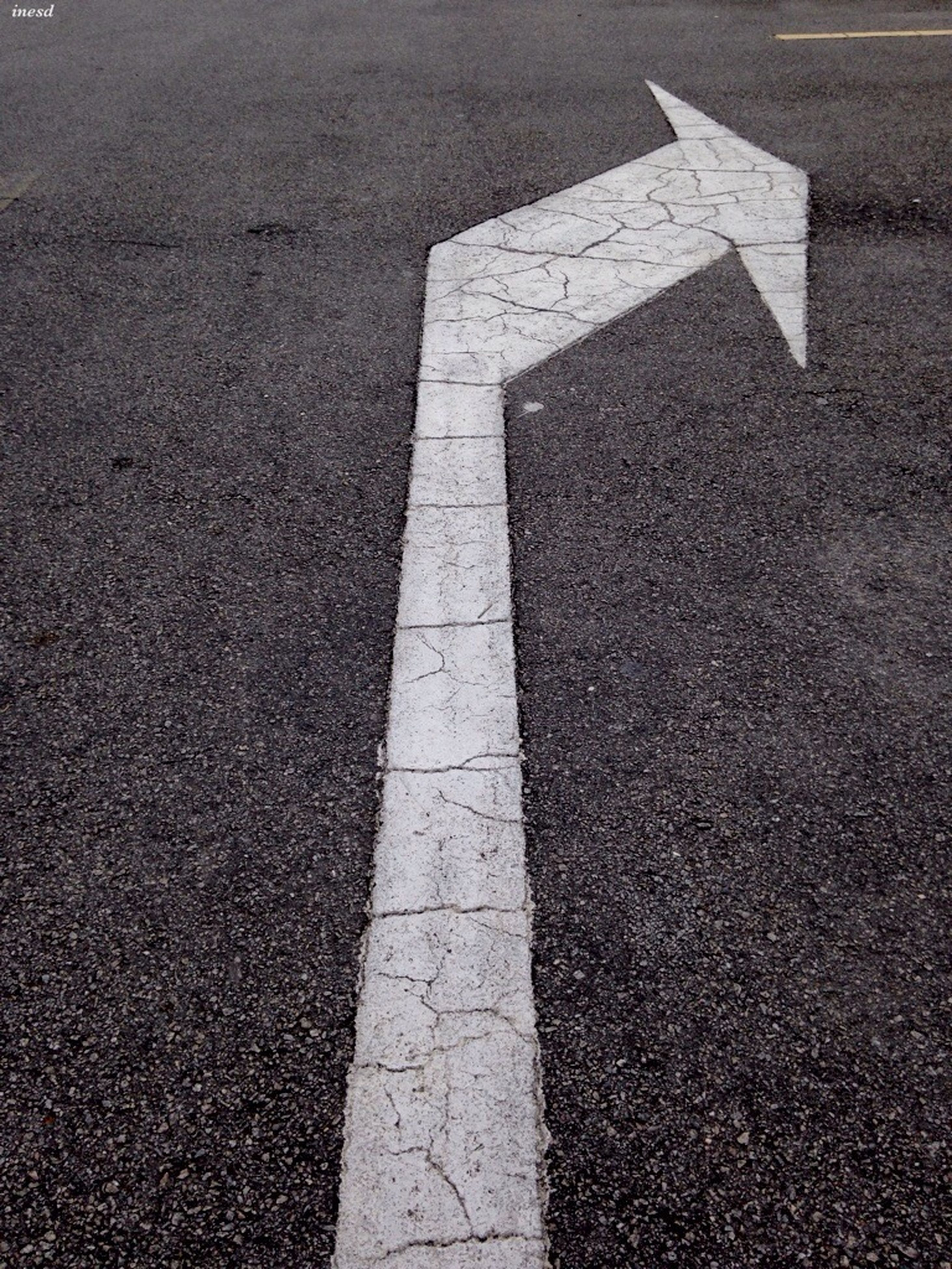 road marking, asphalt, road, street, transportation, high angle view, the way forward, guidance, textured, direction, arrow symbol, outdoors, day, no people, shadow, sunlight, diminishing perspective, vanishing point, white color, directional sign