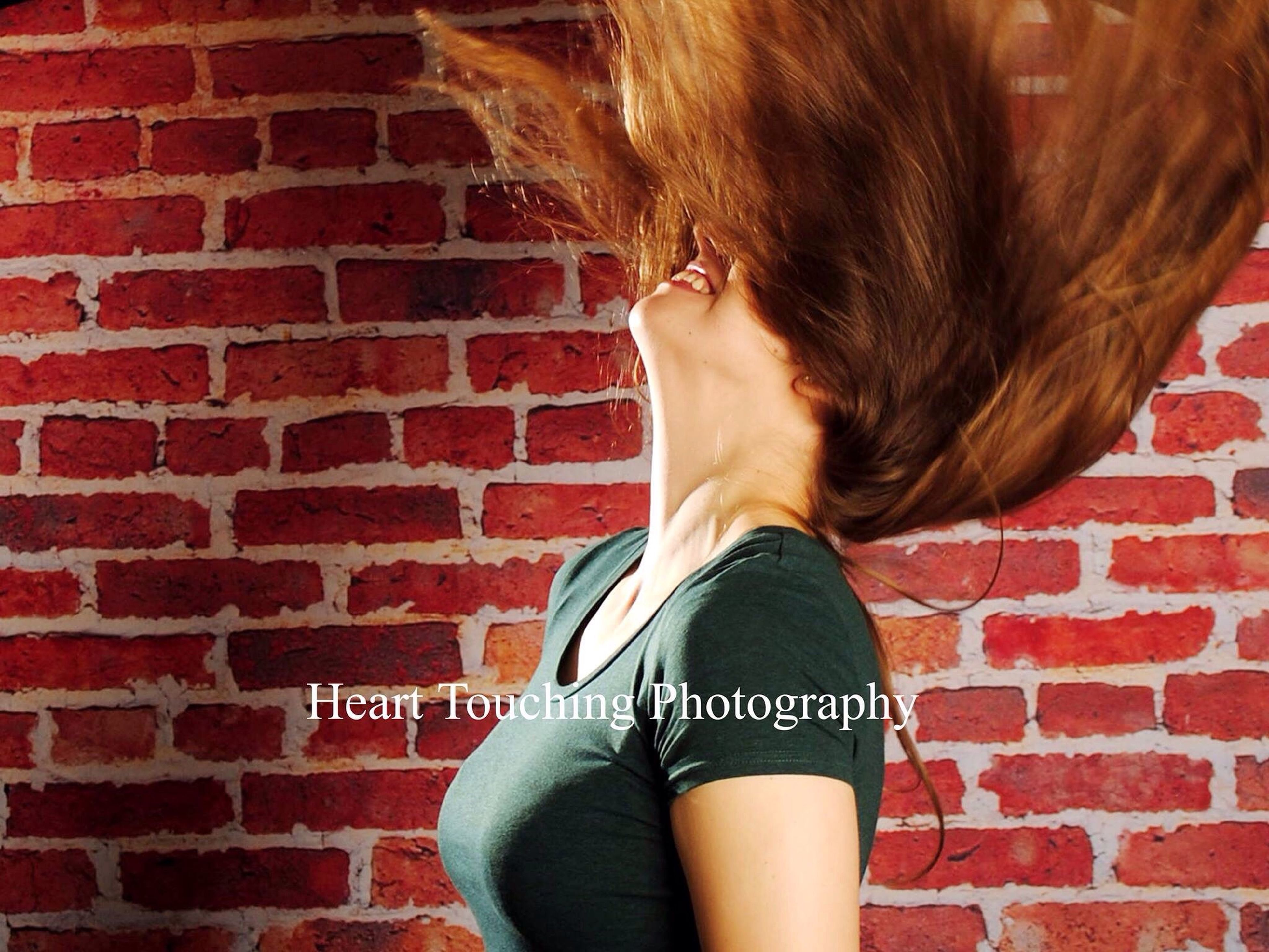 brick wall, wall - building feature, standing, casual clothing, red, outdoors, person