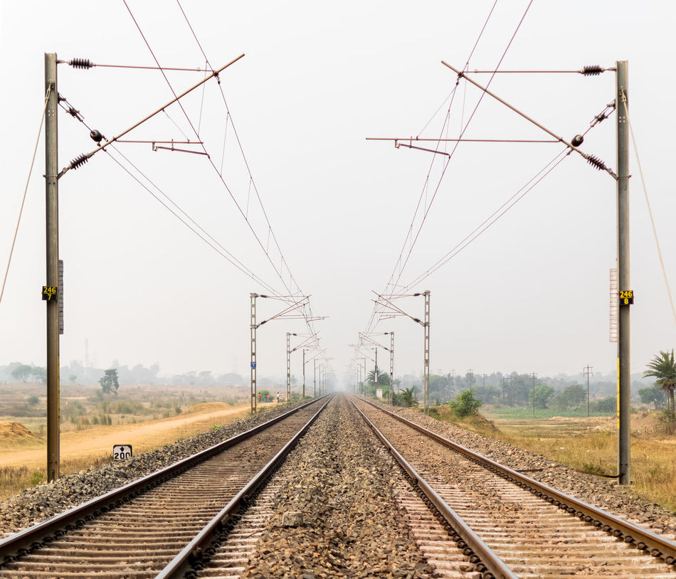 Vanishing point Cable Composition Connection Diminishing Perspective Electricity Pylon Environmental Conservation Incredible India India Journey Outdoors Power Line  Public Transportation Rail Transportation Railroad Track Railway Track Technology Transportation Vanishing Point