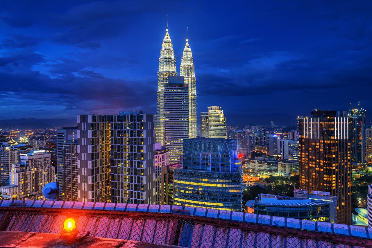 architecture, illuminated, building exterior, built structure, night, skyscraper, sky, city, modern, cityscape, outdoors, cloud - sky, travel destinations, no people, urban skyline