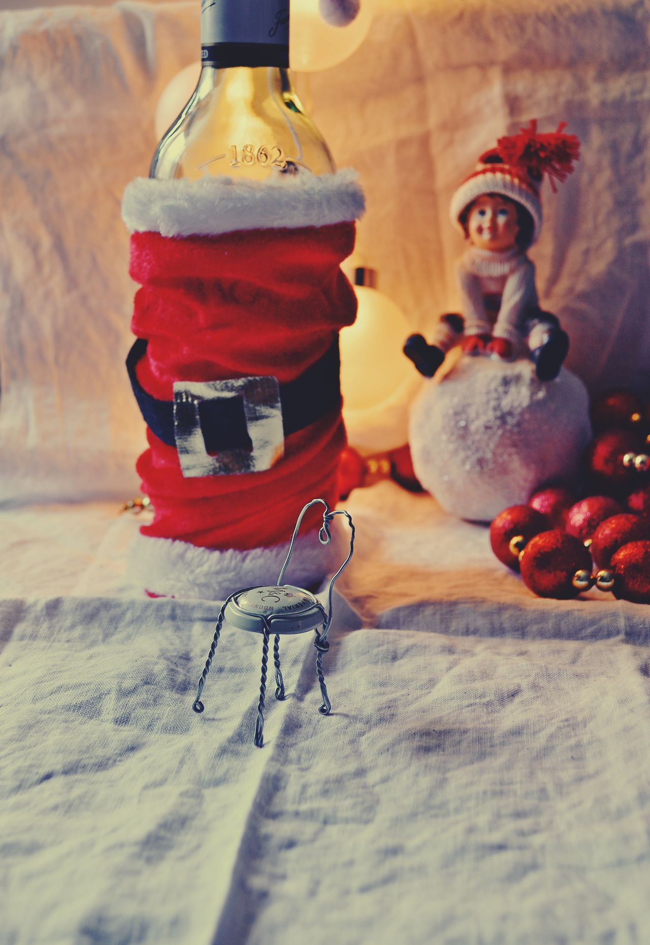 Bottle Christmas Christmas Decoration Christmas Lights Christmas Spirit Close-up Day Dolls Indoors  No People Santa Costume Table Toy Pinup Style BYOPaper!