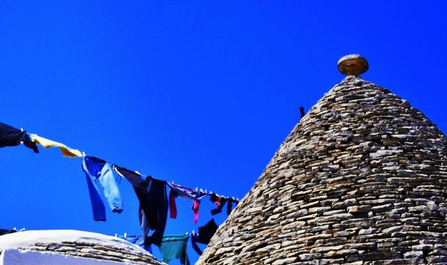 Alberobello Architecture Blue Building Exterior Built Structure Clear Sky Copy Space Cultures Day High Section In A Row Low Angle View Multi Colored No People Outdoors Parasol Pattern Protection Puglia Puglia South Italy Roof Sky Sunlight Trulli Houses Trullilovers