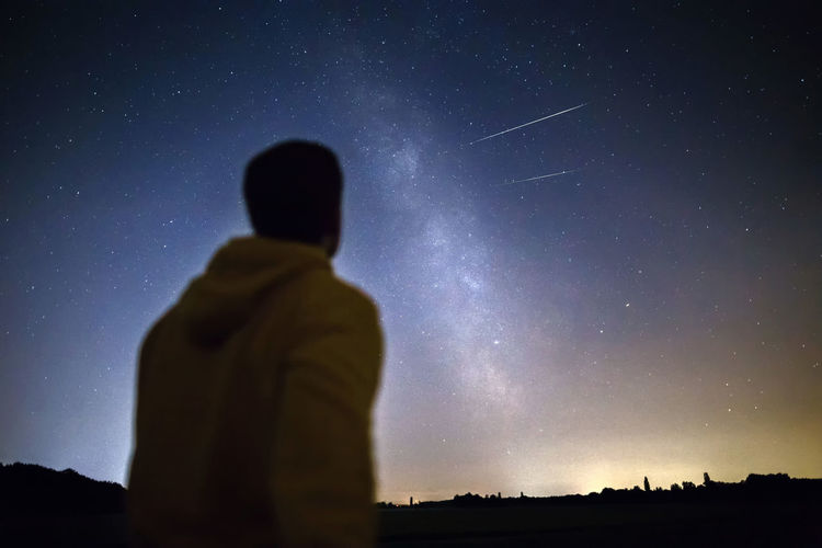 Meteor Thinking Astronomy Clear Sky Explore Galaxy Meteor Shower Milky Way Nature Night One Person Outdoors People Perseid Meteor Shower Rear View Silhouette Sky Space Standing Star - Space Stars Universe